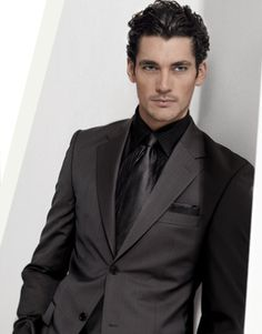 the all-black suit is gorgeous.... All men should have one in ...