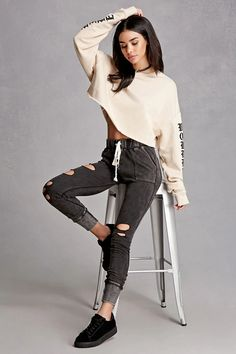 A pair of heathered French terry knit sweatpants in a skinny fit featuring a distressed front, an elasticized drawstring waist, front and back patch pockets, and ribbed trim. This is an independent brand and not a Forever 21 branded item.