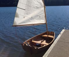 I've been wanting to combine my two favorite hobbies - woodworking and sailing for a long time, so I thought I'd build a boat.  It's got classic lines and looks so...