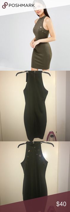 AX Paris Bodycon dress with metal eyelet detail. This dress is super cute! Never worn. Tags still attached. It is a size 10. Fits like a M/L dress. Was a little too tight for me which is why I'm selling it. Great for a night out! AX Paris Dresses Mini