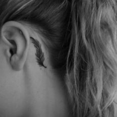 Feathers are verry popular used in ink, but I think this looks verry nice at the back of the ear... By the mastoid.