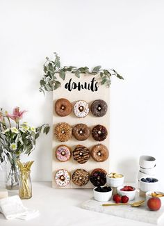 I've been to a few events over the last year with huge donut walls and obviously I fell in love with them. I mean, an entire wall full of donuts?! Yes, please! Sadly, having an 8 foot tall donut wall hanging around for parties isn't exactly practical – so I decided to scale it back …