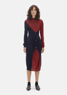 Red and blue long-sleeve dress in finely spun virgin wool with button placket detailing along the seams for an optional wrapped effect. Relaxed, straight fit. W