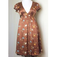 Free People crinkle silk dress Beautiful silk copper dress with floral print, a deep v neckline lined with a chocolate nylon netting that peeks out the bottom. Free People Dresses