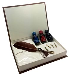 A delightful calligraphy feather pen set with 4 spare nibs, 3 inks and writing paper. The card cover folds up neatly to look like a closed book. A truly superb collection.