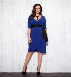 If not wanting to fuss with a wrap style, opt for a faux wrap silhouette.  The Harlow Faux Wrap Dress by Kiyonna is now available in an Egyptian Blue with Black Sash. Perfect for Spring weddings, Easter Sunday service, graduations or any other special occasions. #plussize