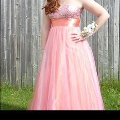 Melon colored prom dress Melon colored prom dress. Only worn once! Beautiful color. Sequenced top. Size 12-14 David's Bridal Dresses Strapless