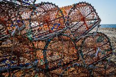 Lobster pots on Cley beach. North Norfolk.