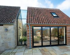 A farmhouse extension with a modern glass link, aluminium bi-folding doors and internal frameless glass balustrades set within a quiet Gloucestershire village. Cottage Extension, House Extension Design, House Design, Garden Room Extensions, House Extensions, Glass Garage Door, Modern Garage, Bathtub Remodel, Dream House Exterior