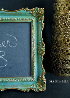 DIY:  How to Paint an Ornate Frame - tutorial shows how this frame was painted, then distressed - via Magia Mia