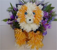 Cat, meow!  Floral animal arrangement made from silk flowers.    Website:  http://epetalsbyelizabeth.com/