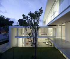 Pitsou Kedem Architects have designed a house for a family in Ramat Hasharon, Israel.