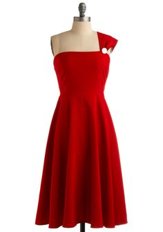 Wow... this is pretty similar to my prom dress. Same color, same neckline, same strap except mine had straps on each shoulder and was floor length. :)