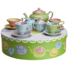 Perfect for a Mad Hatter's tea party, our modern mini tea set is the cutest, coolest way to take tea--just like the grown ups. Colorful pastel colored tea set made of sturdy stoneware and ready for your next tea party! A darling gift idea as this dainty tea set arrives in a round gift box. Available at www.TheShoppingBagStore.com Ships Worldwide! Service for Four 13 Total Pieces 1.5 oz Teacups 11 oz Teapot Material: Stoneware  #tea party, #dress up, #dolls, #little girls, #girly, #toys