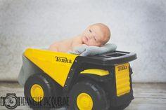 Newborn Baby Boy Laying In Yellow Tonka Truck, Newborn Photo, Newborn Picture Ideas, Newborn Photography in Phoenix Arizona by Professional Photographer Danielle Jacqueline Photography