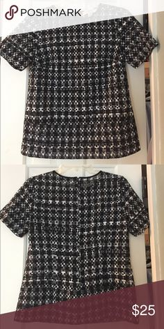 Short Sleeve Eyelet Crew Neck Top Short sleeve eyelet top in black and white. Layer with a tank underneath. Size small. MICHAEL Michael Kors Tops Blouses