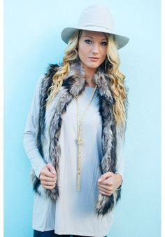"""Faux fur vest now on sale for only $19.99, use code """"rebekaj"""" for an additional discount."""