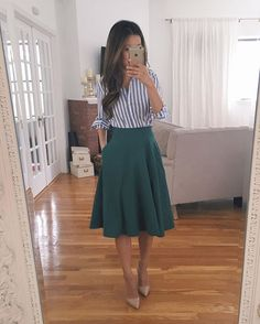Vertical stripes + draped skirt + pointed pumps = an instantly leaner look
