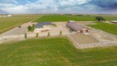 Horse Property for Sale in Weld County in Colorado. A rare find! 3,500+ sq ft ranch home built in 2007, with an 88 x 50 barn. Situated on 56 productive acres with water rights. Current owner has been producing about 8,000 bales of alfalfa annually. This lovely home has an open floor plan, large rooms, and an oversized 3-car attached garage. Gourmet kitchen has slab granite counters, stainless appliances, gas range, double ovens, a large island, built-in hutch and more.