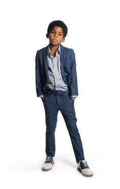 A handsome summerweight suit pairs a two-button, notch-lapel jacket with smart flat-front trousers, and is conveniently machine washable to keep him looking smart event after event. - Jacket has three