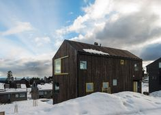 Timber-clad home that sits on a hill overlooking Oslo.
