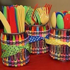 Crayons around the utensil holders