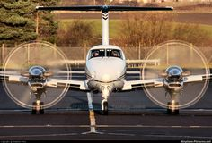 Oh Yeah! Beechcraft King Air 350 on the ramp preparing to taxi to the runway. Those props are being driven by two 1000 horsepower jet turbine engines. Sweeeet!