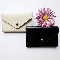 Which would you choose. The black recycled leather card envelope in white or black #dilemma
