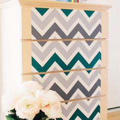 Showcasing a preppy chevron motif in grey and green tones, this peel-and-stick wallpaper square brings regrets-free style to any room. Make a bold statement ...