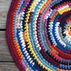 This is a rag rug that Deb crocheted from t-Shirts over at the blog Debs Crochet. Totes awesome!