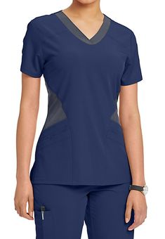 The Barco One Mesh Inset Scrub Top includes roomy pockets and perforated front and back panels. Shop for it at Scrubs & Beyond. Scrubs Uniform, Bodice Pattern, Medical Uniforms, Medical Scrubs, Nursing Clothes, Scrub Tops, Caregiver, Stretch Fabric, Flexibility
