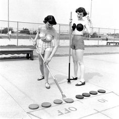 Two models play shuffleboard while wearing a fashion trend that never quite stuck: adhesive bras (Nina LeenThe LIFE Picture Collection/Getty Images) #fashionfriday