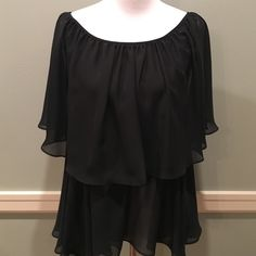 NWT Black flowing top NWT Black flowing top!  Can be worn on shoulders or just on one.  Great condition! Basically Me Tops Blouses