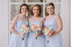 Gorgeous Walt Disney World bridesmaids in matching light blue gowns