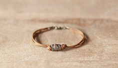 Men's bracelet with a bronze Hamsa and fish lucky by Principles