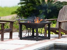 This decorative fire pit from Casual Image doubles as a charming cocktail table. The Cocktail #Firepit table features a large fire box and lower log storage rack. A steel cover converts the fire pit into the perfect cocktail table with ease, ideal for any #patiofurniture combination.