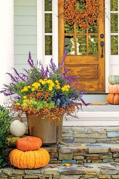 "First, encircle a copper container with a bittersweet wreath (fresh or faux). To contrast with the orange berries, add ""Lemon Ball"" sedum and the regal hues of purple cabbage. Spice up the center with ""Calypso Orange"" ornamental peppers and ""Cosmic Yellow"" cosmos. Crown the look with a halo of Mexican bush sage. Stack pumpkins on the steps for additional color. Provide full sun and moderate water and the display will flourish through the fall"