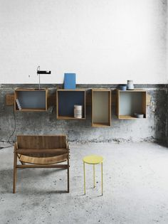 perfection! love the concrete, love the yellow table, love the boxes (much nicer than old crates that are everywhere!)