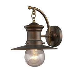 Lend a classic touch to your patio or parlor ensemble with this eye-catching wall lantern, featuring a hazelnut bronze finish and industrial-chic design.