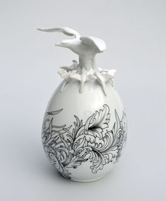 Previously working with the female figure in her sculptural pieces mentionedhere and here, Juliette Clovis' newest series of porcelain sculptures is centered around the form of an egg. Each was crafted by Clovis in La Manufacture La Seynie, the oldest Limoges porcelain manufacturer in France. Some