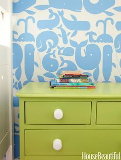 "Little Whales from Walnut Wallpaper is a buoyant backdrop for a dresser Ewart painted so that ""every room has at least a peek of green.""   - HouseBeautiful.com"