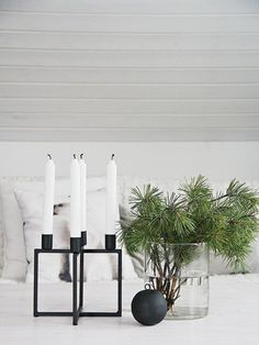 Simple Ways To Decorate Your Home For Christmas Fill vases with pine branches as simple holiday decor. // branch in vase, simple Christmas decor, minimalist holiday decor, Scandinavian Christmas decor Scandinavian Christmas Decorations, Scandi Christmas, Modern Christmas Decor, Christmas Interiors, Noel Christmas, Holiday Decor, Xmas, Christmas Candles, Minimal Christmas
