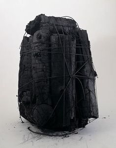 Prometheus: Bound charcoal logs. Unattributable, imagery uploaded with no provenance.