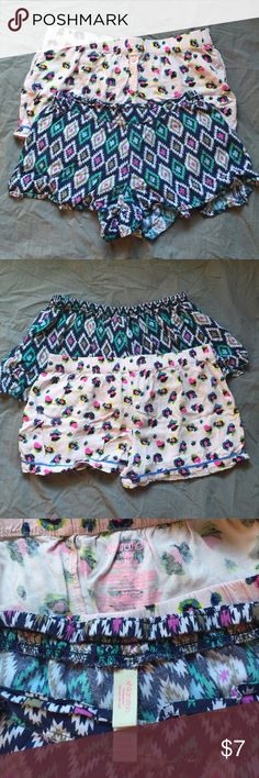Pair of Xhilaration Sleep Shorts •Excellent •2 pair of Medium Xhilaration sleep shorts. One is light pink with multicolor leopard spots, and 3 button detail, worn once. The second is multicolor (blues, purple, teal, white) Aztec style print with 'flared' leg openings, worn just a few times. ~sleep, sleepwear, pajamas, pjs, target, premise bundle~  ❗️Please ask any & all questions before buying! 🚫No holds 🚫No trades Xhilaration Intimates & Sleepwear Pajamas
