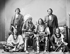 Ponca chiefs: 1877 photo features Big Elk, Standing Buffalo Bull, White Eagle, and Standing Bear. Standing are John Baptist LeClair and Charles LeClair.