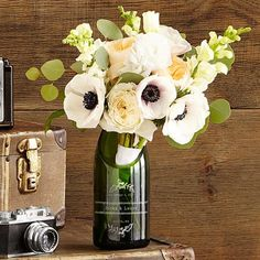 Are you looking to give the bride and groom something that isn't already on their registry? Check out these 28 bridal shower gifts that are totally one-of-a-kind! #bridalshowergifts #uniquebridalshowergifts #bridalshowergiftideas #ModernMOH Personalized Bridal Shower Gifts, Unique Bridal Shower Gifts, Wedding Bottles, Wedding Vases, Wedding Champagne, Wedding Bouquet, Wedding Keepsakes, Wedding Gifts, Bottle Centerpieces