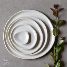 Handmade ceramic pebble plate, made from white porcelain clay and hand-brushed with a white gloss glaze. Each piece is shaped and glazed entirely by hand, creating a gorgeous organic feel with no two pieces exactly the same. The edges of and base of the pieces are left unglazed, creating a beautiful subtle contrast for classic white dinnerware with a twist.  If the pieces you are after are not in stock we can make them to order especially for you in our Sunshine Coast studio. For current…