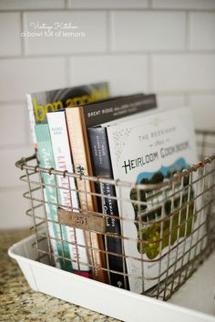 Add a vintage touch to your kitchen by tucking some of your favorite cookbooks into an antique basket for display.