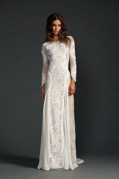 Boho chic. Long sleeved beaded lace wedding dress.