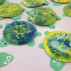 Cute turtles make testing days much more fun.I love these little turtles so much and so do my kindergartners.  This may just be the Night of the Arts project for kindergarten next year.  This lesson took three days.  On the first, we mixed green paint and painted the paper plate.  During the next class, we printed circles and traced the legs and head.  We drew the eyes with oil pastel, cut out the pieces, and glued it all together using glue sponges during the last class.